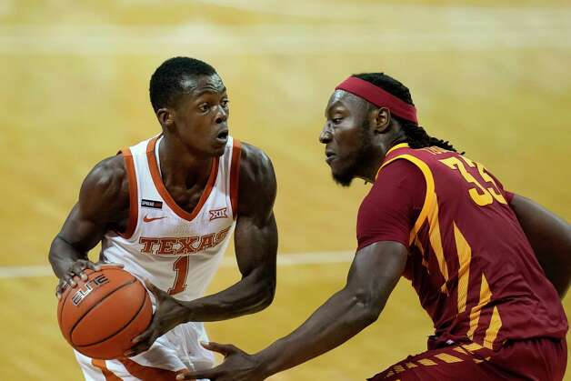 Texas guard Andrew Jones looks to pass around Iowa State forward Solomon Young, right, during the first half of an NCAA college basketball game, Tuesday, Jan. 5, 2021, in Austin, Texas. (AP Photo/Eric Gay) Photo: Eric Gay, Associated Press / Copyright 2021 The Associated Press. All rights reserved.