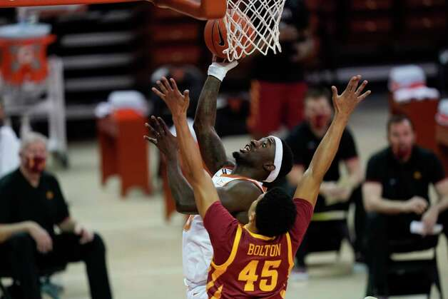 Texas guard Courtney Ramey drives to the basket over Iowa State guard Rasir Bolton (45) during the first half of an NCAA college basketball game, Tuesday, Jan. 5, 2021, in Austin, Texas. (AP Photo/Eric Gay) Photo: Eric Gay, Associated Press / Copyright 2021 The Associated Press. All rights reserved.