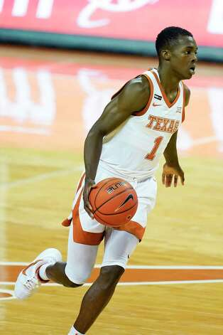 Texas guard Andrew Jones drives up court during the first half of an NCAA college basketball game against Iowa State, Tuesday, Jan. 5, 2021, in Austin, Texas. (AP Photo/Eric Gay) Photo: Eric Gay, Associated Press / Copyright 2021 The Associated Press. All rights reserved.