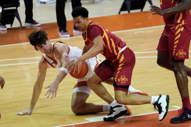 Texas forward Brock Cunningham, left, fights for a loose ball with Iowa State guard Rasir Bolton, right, during the first half of an NCAA college basketball game, Tuesday, Jan. 5, 2021, in Austin, Texas. (AP Photo/Eric Gay) Photo: Eric Gay, Associated Press / Copyright 2021 The Associated Press. All rights reserved.