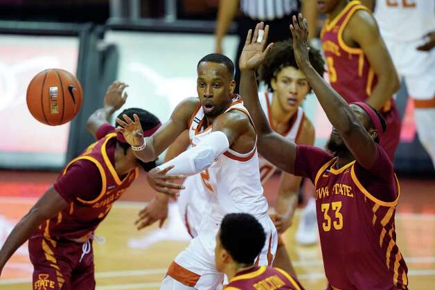 Texas guard Matt Coleman III, center, passes ahead of Iowa State forward Solomon Young (33) during the first half of an NCAA college basketball game, Tuesday, Jan. 5, 2021, in Austin, Texas. (AP Photo/Eric Gay) Photo: Eric Gay, Associated Press / Copyright 2021 The Associated Press. All rights reserved.