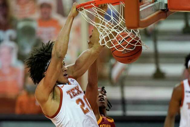 Texas forward Jericho Sims dunks the ball during the first half of an NCAA college basketball game against Iowa State, Tuesday, Jan. 5, 2021, in Austin, Texas. (AP Photo/Eric Gay) Photo: Eric Gay, Associated Press / Copyright 2021 The Associated Press. All rights reserved.