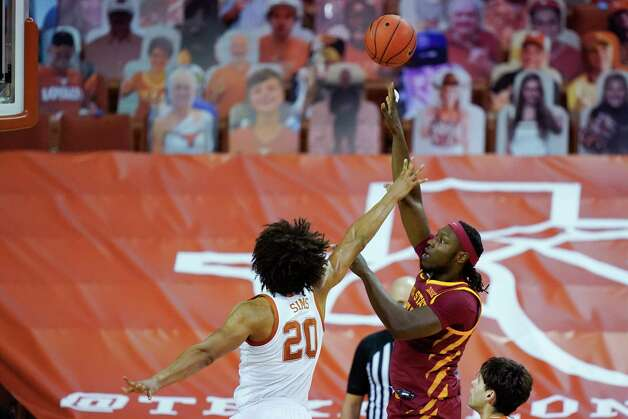Iowa State forward Solomon Young shoots over Texas forward Jericho Sims (20) during the first half of an NCAA college basketball game, Tuesday, Jan. 5, 2021, in Austin, Texas. (AP Photo/Eric Gay) Photo: Eric Gay, Associated Press / Copyright 2021 The Associated Press. All rights reserved.