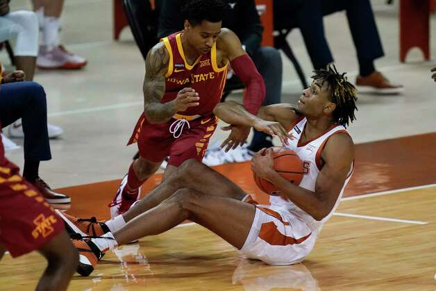 Iowa State guard Tyler Harris fights for a loose ball with Texas forward Greg Brown, right, during the first half of an NCAA college basketball game, Tuesday, Jan. 5, 2021, in Austin, Texas. (AP Photo/Eric Gay) Photo: Eric Gay, Associated Press / Copyright 2021 The Associated Press. All rights reserved.