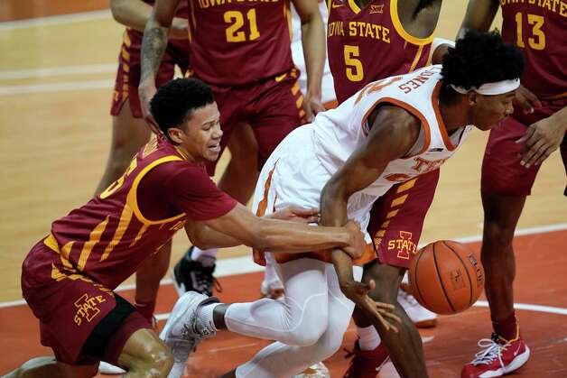 Iowa State guard Rasir Bolton, left, tries to steal the ball from Texas forward Kai Jones during the first half of an NCAA college basketball game, Tuesday, Jan. 5, 2021, in Austin, Texas. (AP Photo/Eric Gay) Photo: Eric Gay, Associated Press / Copyright 2021 The Associated Press. All rights reserved.