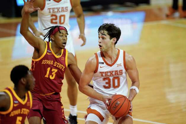 Texas forward Brock Cunningham (30) drives past Iowa State forward Javan Johnson (13) during the first half of an NCAA college basketball game, Tuesday, Jan. 5, 2021, in Austin, Texas. (AP Photo/Eric Gay) Photo: Eric Gay, Associated Press / Copyright 2021 The Associated Press. All rights reserved.