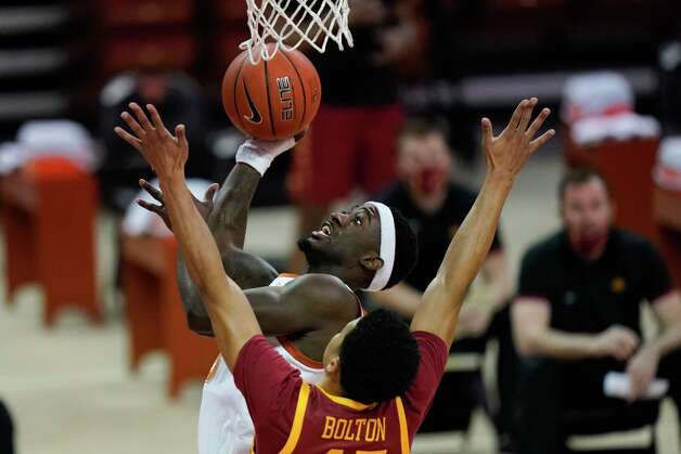 Texas guard Courtney Ramey drives to the basket over Iowa State guard Rasir Bolton during the first half of an NCAA college basketball game, Tuesday, Jan. 5, 2021, in Austin, Texas. (AP Photo/Eric Gay) Photo: Eric Gay, Associated Press / Copyright 2021 The Associated Press. All rights reserved.
