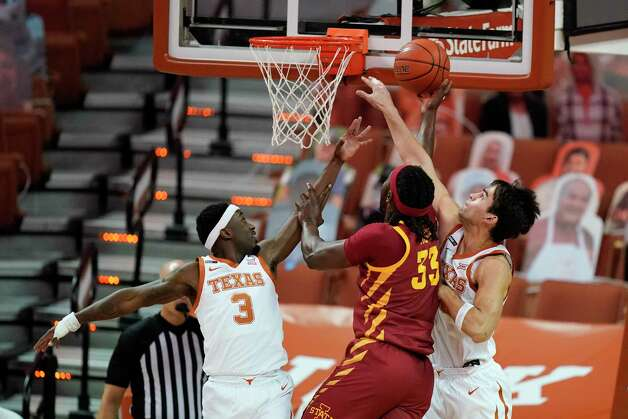 Iowa State forward Solomon Young, center, drives to the basket between Texas guard Courtney Ramey, left, and forward Brock Cunningham, right, during the first half of an NCAA college basketball game, Tuesday, Jan. 5, 2021, in Austin, Texas. (AP Photo/Eric Gay) Photo: Eric Gay, Associated Press / Copyright 2021 The Associated Press. All rights reserved.