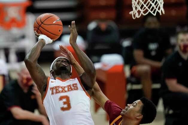 Texas guard Courtney Ramey (3) drives to the basket over Iowa State guard Rasir Bolton, right, during the first half of an NCAA college basketball game, Tuesday, Jan. 5, 2021, in Austin, Texas. (AP Photo/Eric Gay) Photo: Eric Gay, Associated Press / Copyright 2021 The Associated Press. All rights reserved.