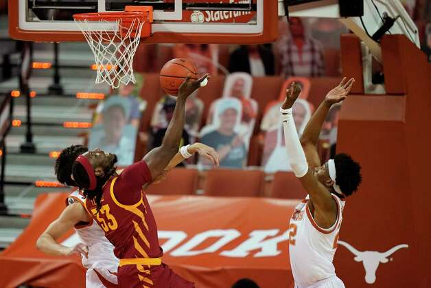Iowa State forward Solomon Young (33) drives to the basket in front of Texas forward Kai Jones, right, during the first half of an NCAA college basketball game, Tuesday, Jan. 5, 2021, in Austin, Texas. (AP Photo/Eric Gay) Photo: Eric Gay, Associated Press / Copyright 2021 The Associated Press. All rights reserved.