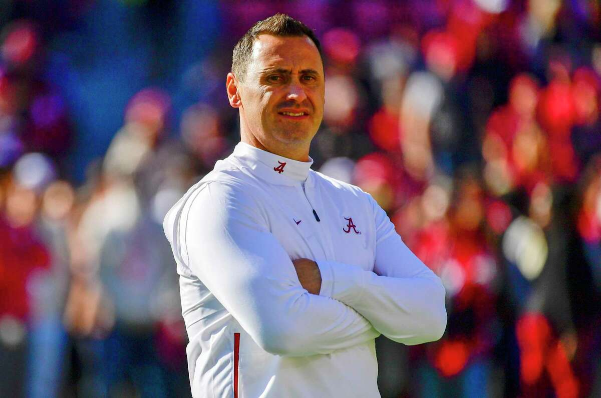 In this Nov. 9, 2019 photo, Alabama offensive coordinator Steve Sarkisian watches warmups before a game against LSU in Tuscaloosa, Ala. Texas has hired Sarkisian as the Longhorns new coach. The move comes just a few hours after Texas announced the firing of Tom Herman after four seasons with no Big 12 championships.