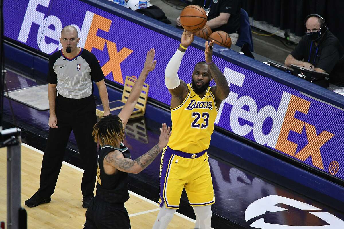 LeBron James had 26 points and 11 rebounds in Los Angeles' 94-92 win over the struggling Grizzlies.