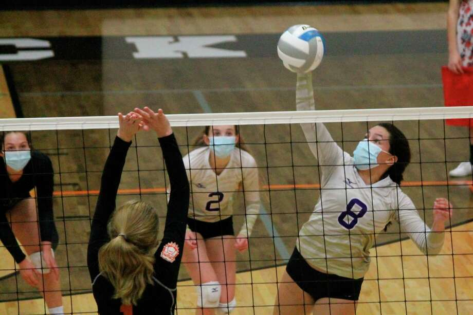 After being allowed to take off their masks while on the court for the first few weeks of the season, volleyball players were called on to mask up at all times beginning in early September. (Record Patriot File Photo)
