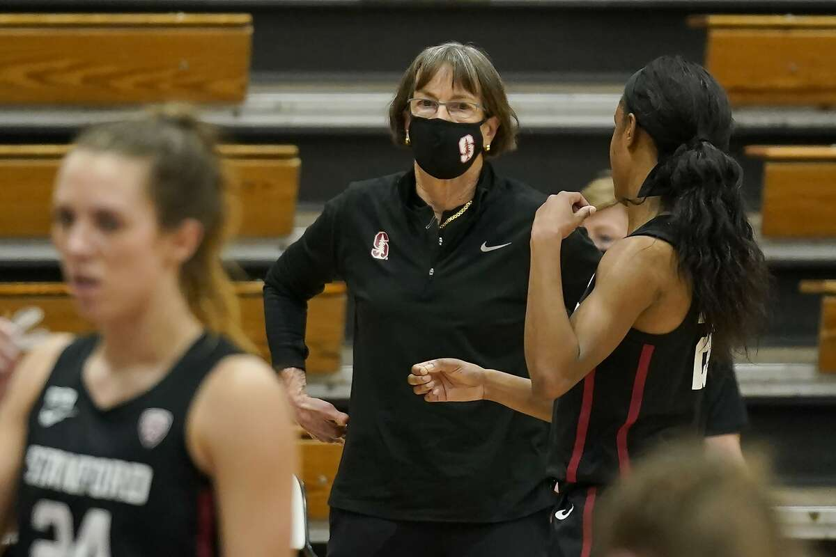 Stanford head coach Tara VanDerveer talks with guard Kiana Williams during a break in the action against Pacific in the first half of an NCAA college basketball game in Stockton , Calif., Tuesday, Dec. 15, 2020. Stanford's 104-61 win over Pacific, made VanDerveer the winningest women's basketball coach in history with 1,099 victory's breaking the previous record set by Pat Summitt.