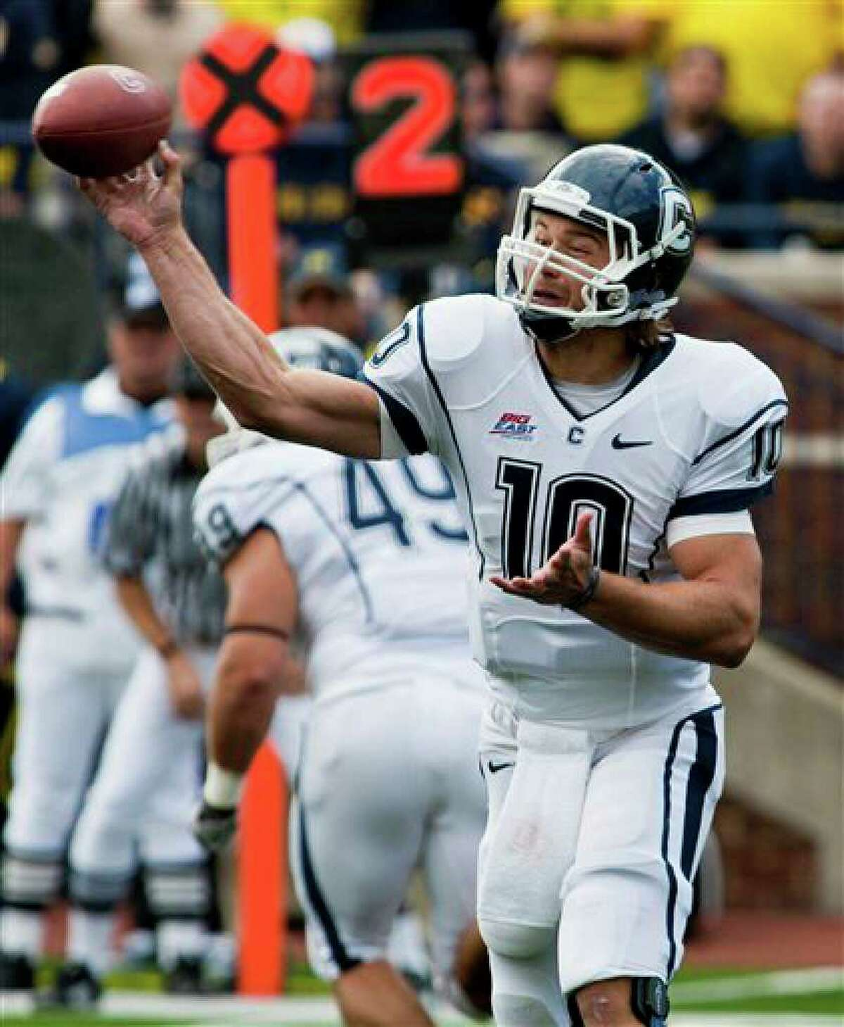 Connecticut quarterback Zach Frazer throws a pass in the second quarter of an NCAA college football game against Michigan, Saturday, Sept. 4, 2010, in Ann Arbor, Mich. (AP Photo/Tony Ding)