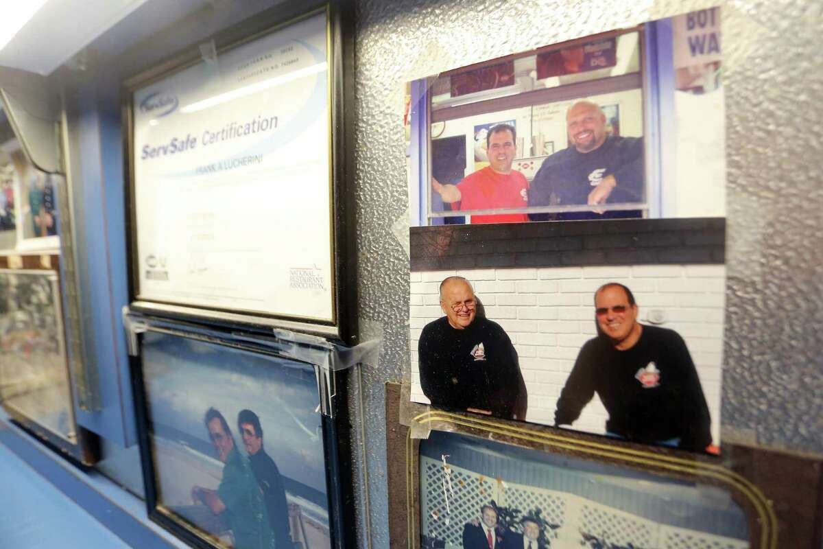A photo of Dairy Queen owner Frank Lucherini Jr., and his father Frank Lucherini Sr., on the wall in the ice cream shop's office.