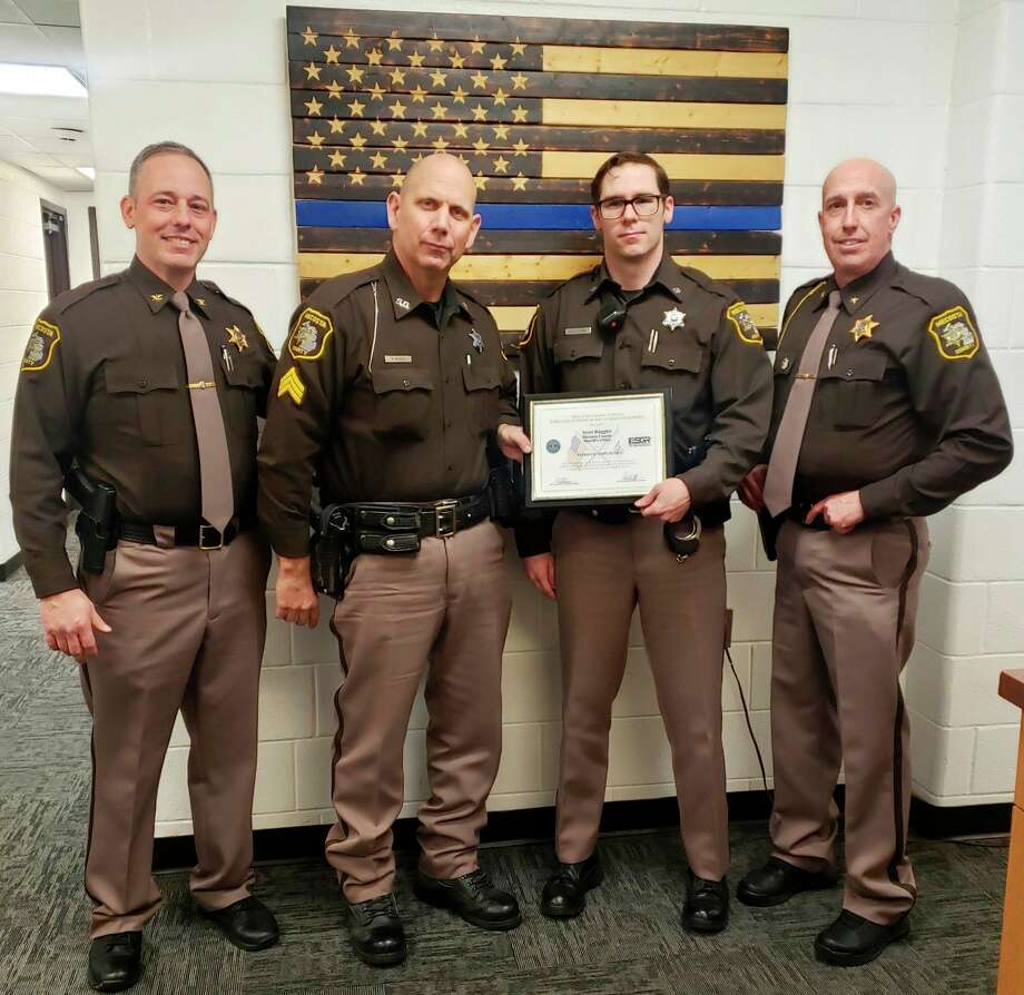 A member of the Mecosta County Sheriff's Office recently received national recognition. Last summer, Dep. David Dantuma nominated Sgt. Scott Ruggles for the Service Member Patriot Award, a nationally-recognized honor through the Employer Support for Guard and Reserve. Ruggles was selected as this year's recipient. Pictured from the Mecosta County Sheriff's Office (from left) is: Undersheriff Mike Williams, Sgt. Scott Ruggles, Dep. David Dantuma, and Sheriff Brian Miller. (Courtesy photo)