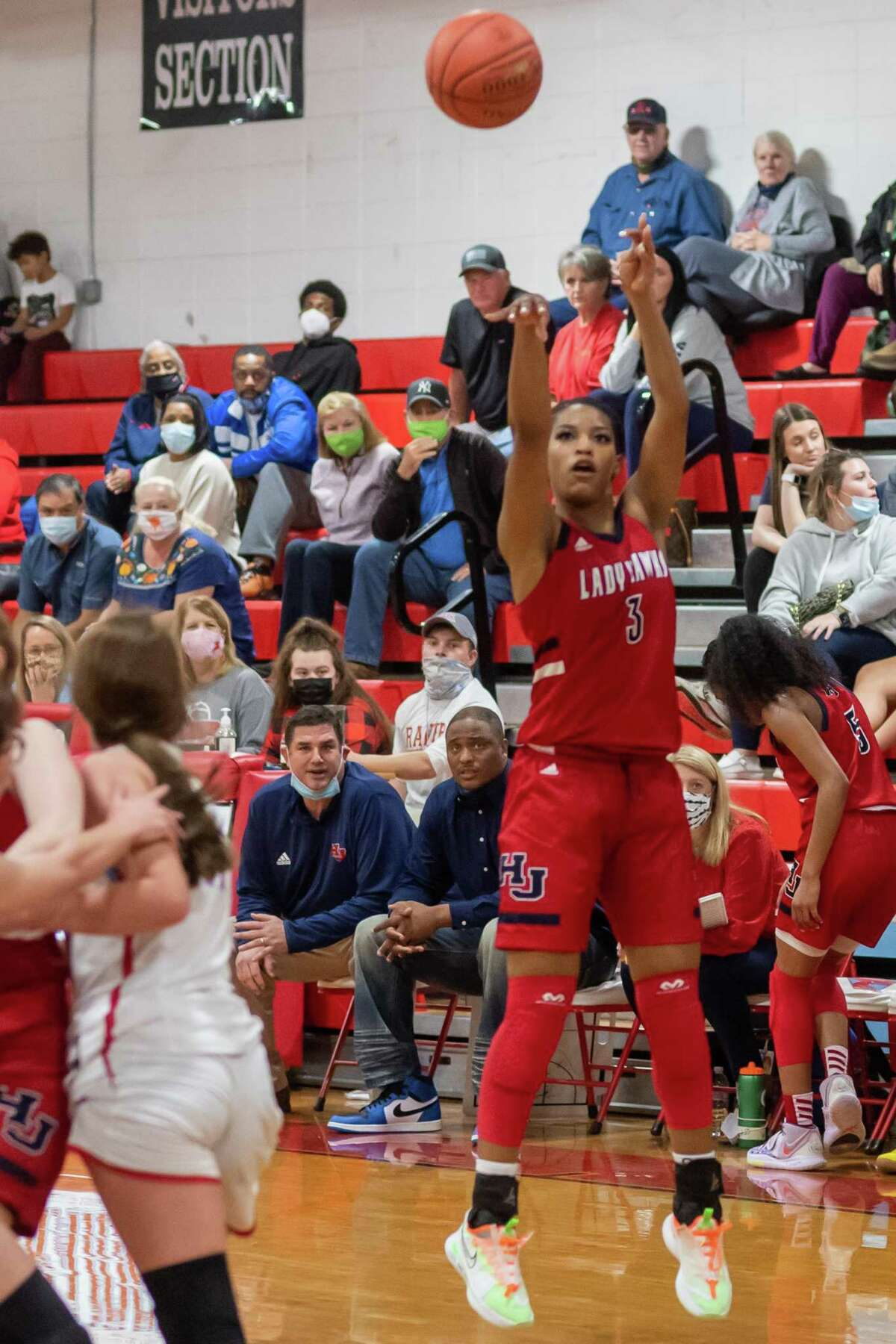 H-J's Ashlon Jackson (3) puts up a shot in the third quarter. The Lady Hawks of Hardin-Jefferson took their winning ways to Lumberton where they downed the Lady Raiders in a physical game with the final score of 98-50. Photo made on December 30, 2020. Fran Ruchalski/The Enterprise