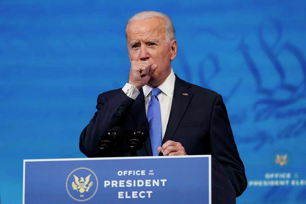 President-elect Joe Biden clears his throat as he speaks after the Electoral College formally elected him as president, Monday, Dec. 14, 2020, at The Queen theater in Wilmington, Del.
