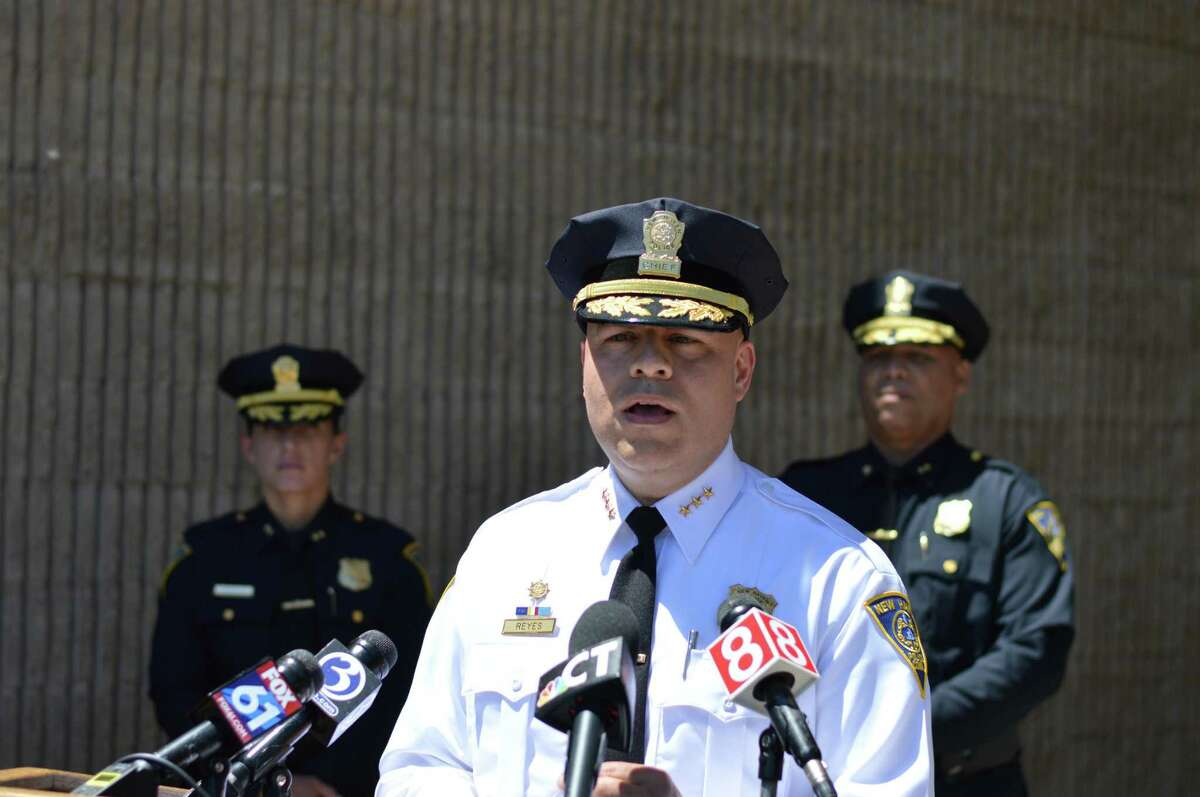 New Haven Police Chief Otoniel Reyes, center, Tuesday announced his plans to retire.