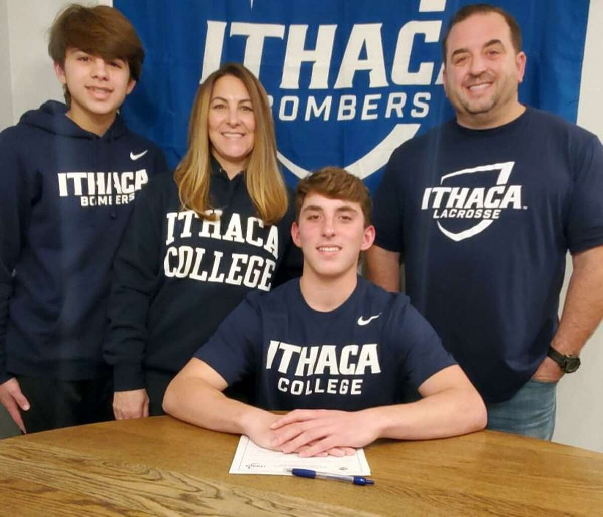 Shelton's Jared Sedlock is joined by brother Logan. mom Tracey and dad Drew when he officially chose to play lacrosse at Ithaca College.