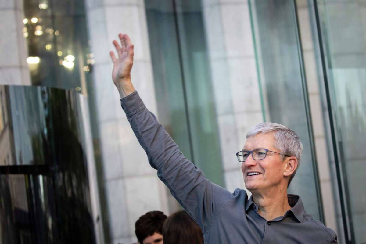 Amid reports that Apple once again plans to develop a driverless car, Tesla Chief Executive Elon Musk has revealed he sought to interest Apple Chief Executive Tim Cook, shown, in buying his company. (Drew Angerer/Getty Images/TNS)
