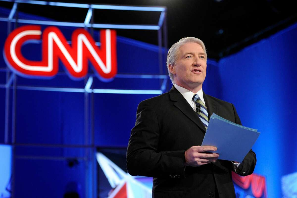 CNN correspondent John King explains to Americans the numbers in the Georgia runoff election. (Photo by Ethan Miller/Getty Images)