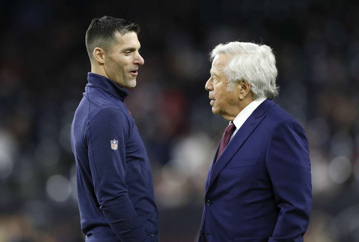 Director of player personnel Nick Caserio of the New England Patriots talks with owner Robert Craft before the game against the Houston Texans at NRG Stadium on December 1, 2019 in Houston.