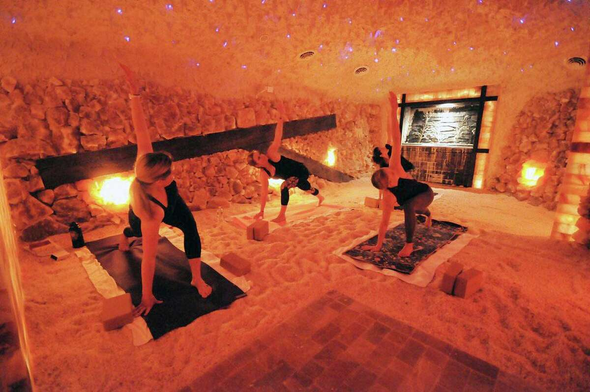 Patrons practice yoga at the Salt Cave of Darien.