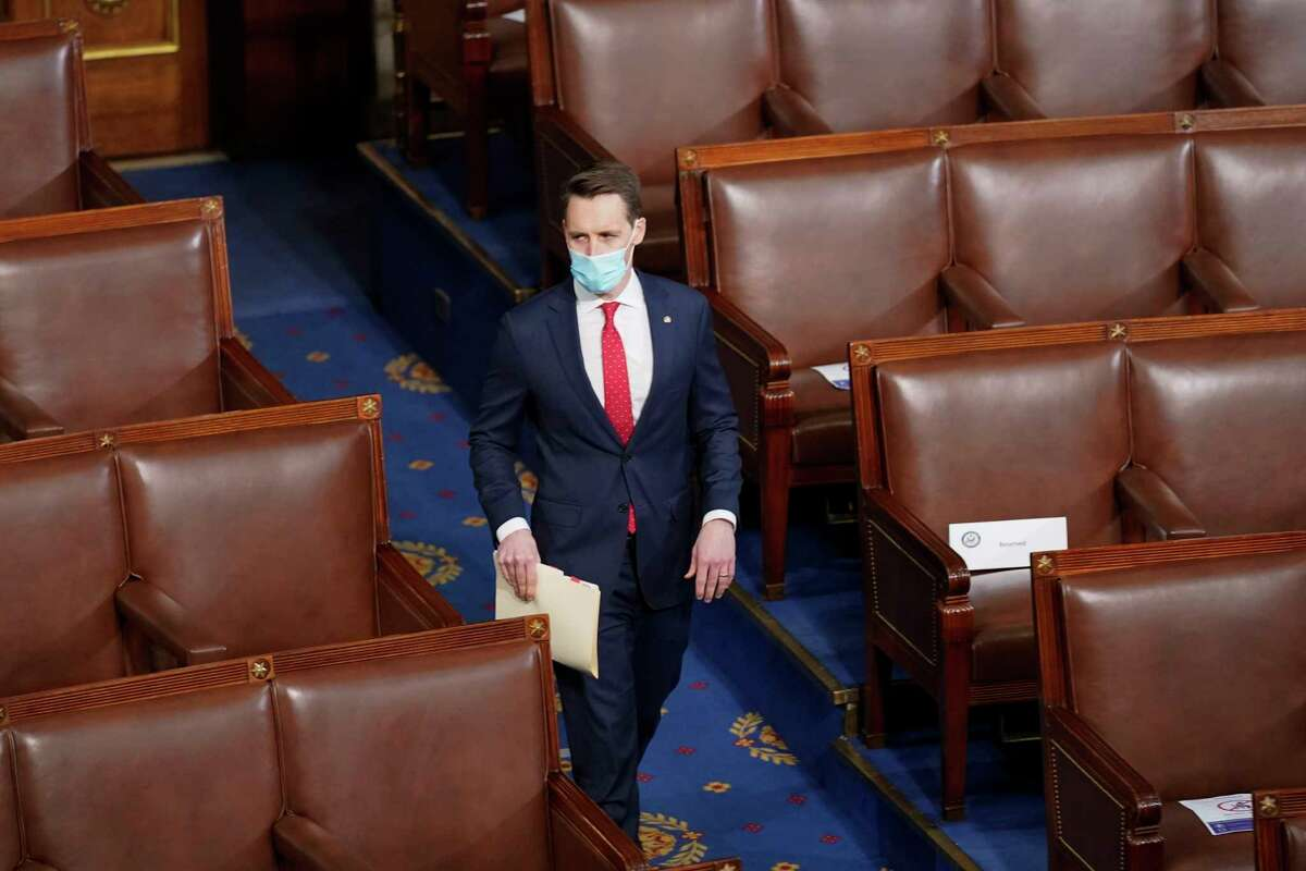 Sen. Josh Hawley, R-Mo., walks into the House chamber before a joint session of the House and Senate convenes to count the electoral votes cast in November's election, at the Capitol, Wednesday, Jan 6, 2021.