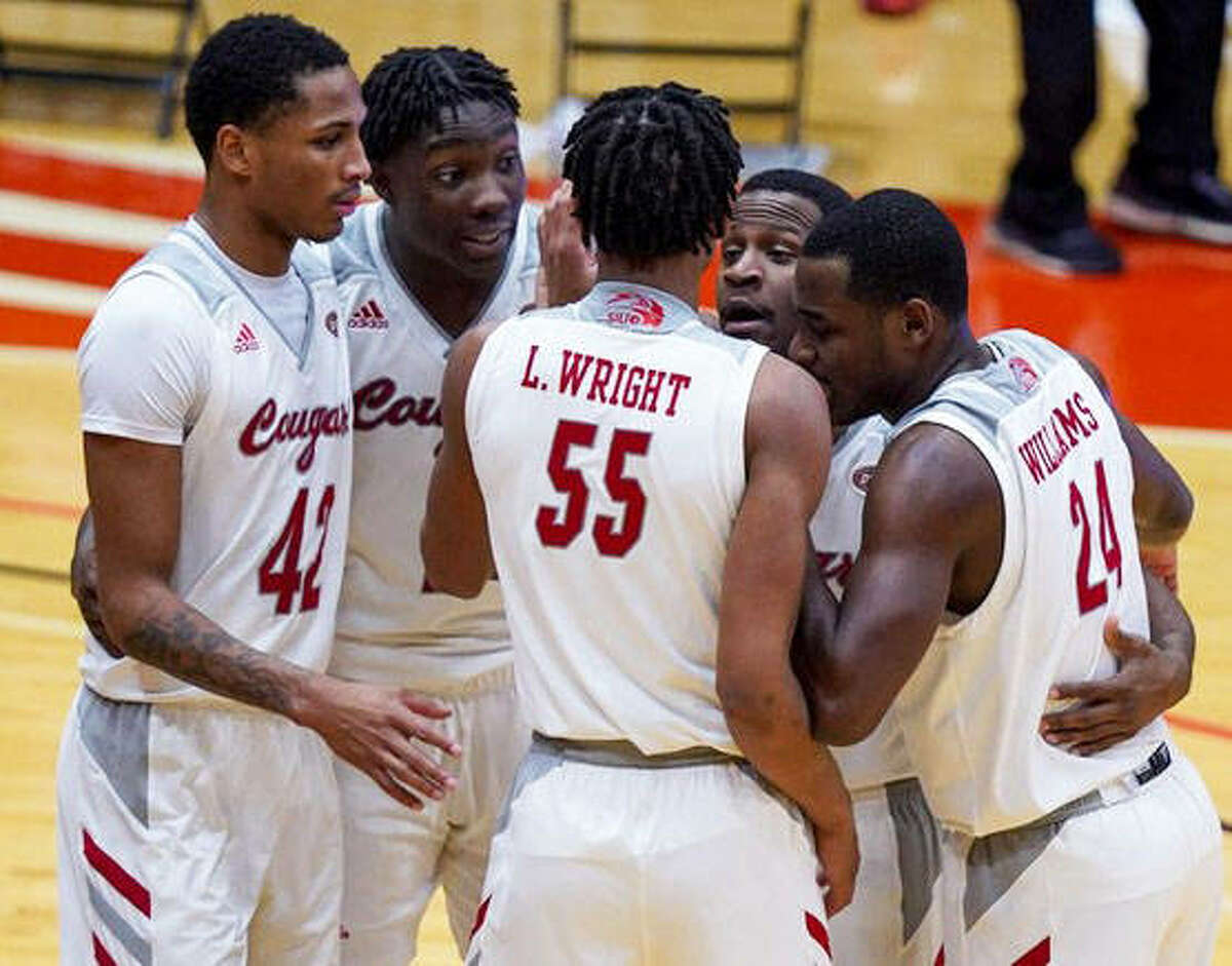 Members of the SIUE men's basketball team huddle together during a break in action during a home game against the University of Nebraska-Omaha.