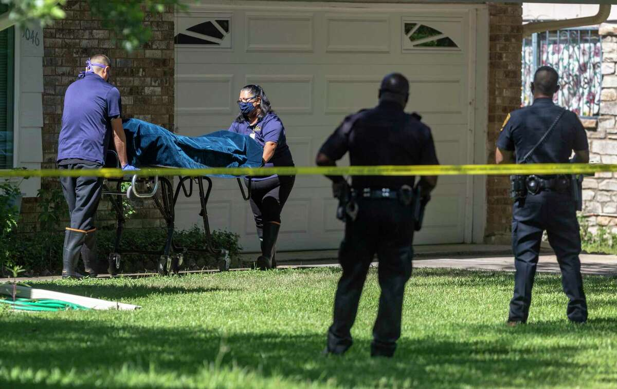 The body of one of the two people killed June 11, 2020, is removed from a home in the 5000 block of Round Table Drive. A 50-year-old woman shot and killed her parents at the home before turning the gun on herself, San Antonio Police Chief William McManus said.