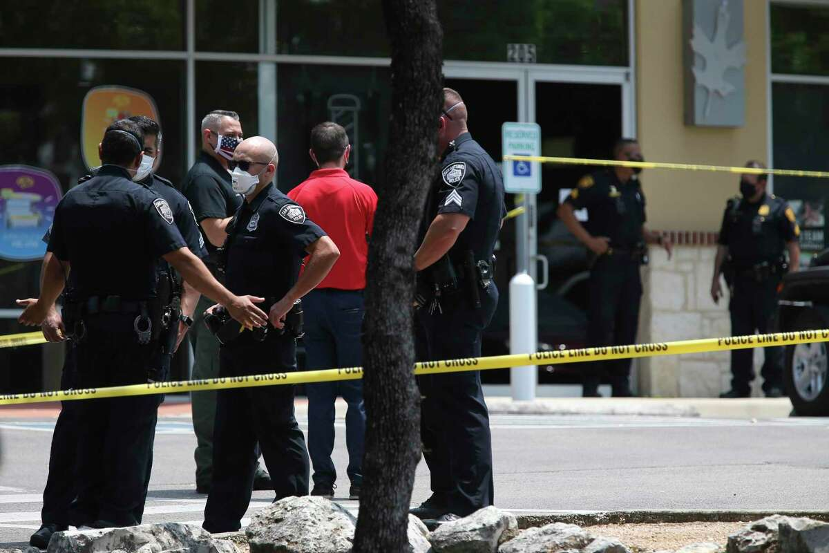 San Antonio police investigate a homicide at Diesel Barbershop in the 11300 block of Bandera Road on May 6, 2020. According to San Antonio Police Chief William McManus, a male in his 30s is believed to have shot a woman, who died at the shop. He also is suspected of stabbing a second woman who was transported to a local hospital.