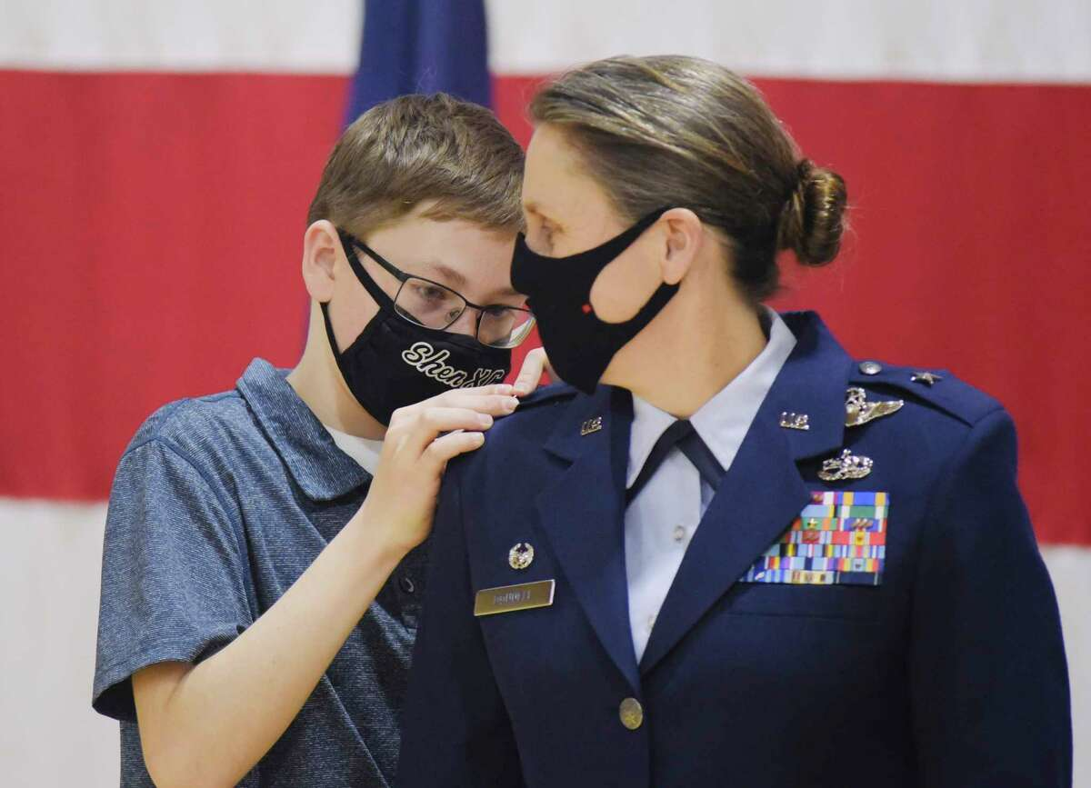Maximilian Szczesny, 14, pins a star on his mom, newly promoted Brigadier General Denise Donnell, at her promotion ceremony at the New York National Guard Headquarters on Wednesday, Jan. 6, 2021, in Latham, N.Y. Brigadier General Donnell, a Clifton Park resident and a graduate of the United States Military Academy, is the commander of the 105th Airlift Wing at Stewart Air National Guard Base in Newburgh, and oversees a wing of more than 1300 military personnel. (Paul Buckowski/Times Union)