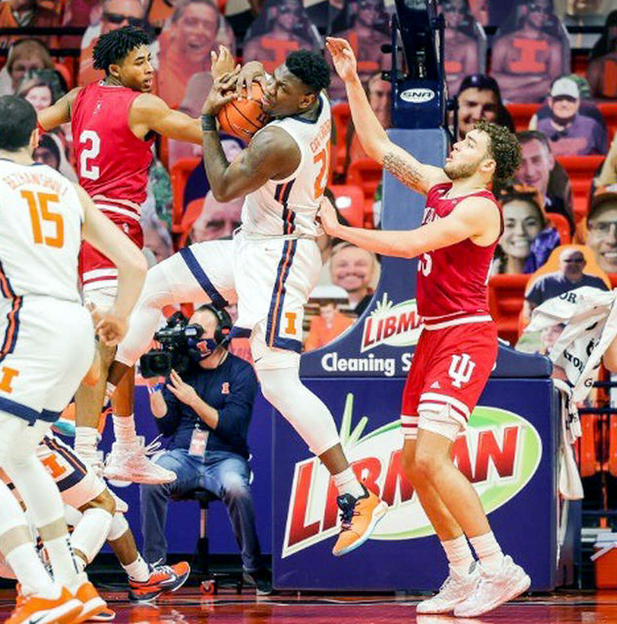 Kofi Cockburn of Illinois, center, pulls down a rebound in a game against Indiana last week at State Farm Center in Champaign.