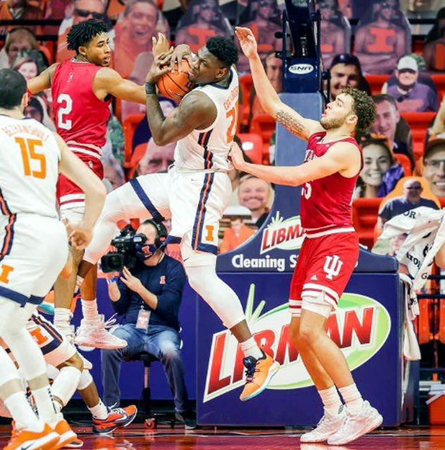 Kofi Cockburn of Illinois, center, pulls down a rebound in a game against Indiana last week at State Farm Center in Champaign. Photo: Andy Wenstrand | Illinois Athletics