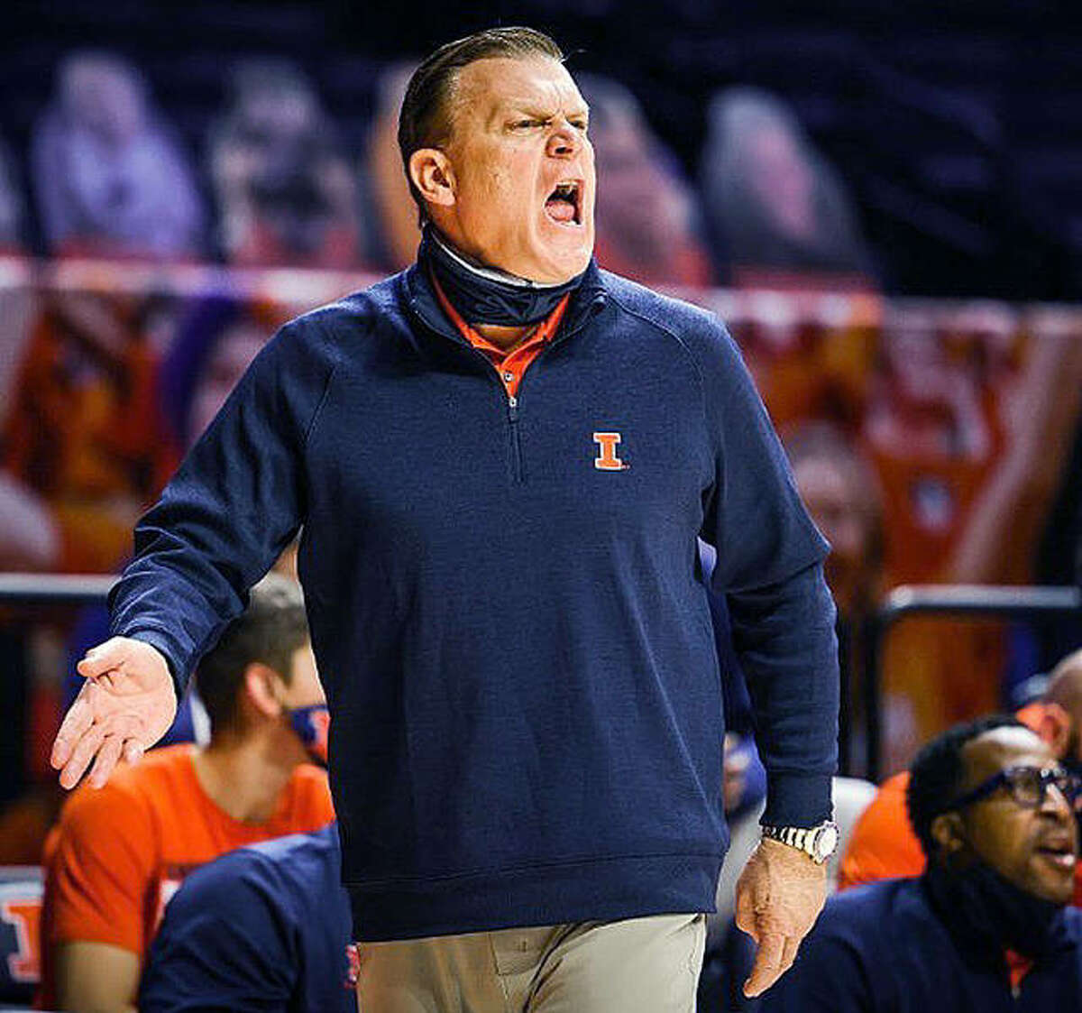 Fighting Illini basketball coach Brad Underwood shouts instructions to his team last week against Indiana.
