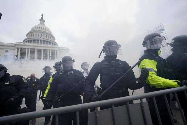 Police stand guard after holding off Trump supporters who tried to break through a police barrier, Wednesday, Jan. 6, 2021, at the Capitol in Washington. Photo: Julio Cortez/AP / Copyright 2021 The Associated Press. All rights reserved.