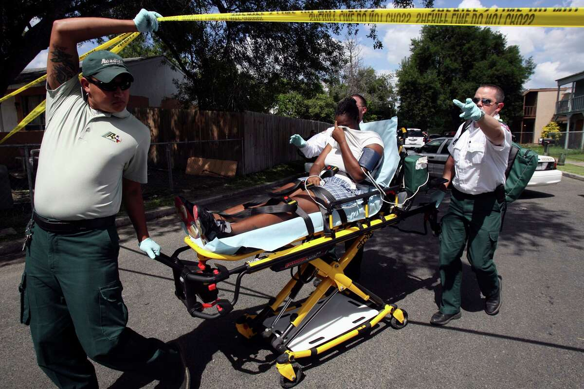 Ambulance workers transport a woman on a gurney in August 2010. An argument in the neighborhood turned into a melee with shots fired and fights breaking out, injuring several people. A new customized app provided by the 100 Club of San Antonio to all first responders in Bexar County will allow them to seek help for handling personal issues - everything from parenting and finances to handling alcohol abuse and the effects of trauma - anonymously.