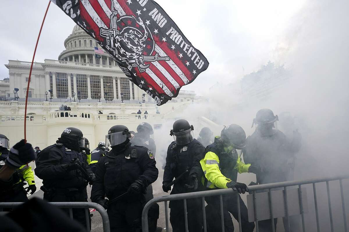Police hold off Trump supporters who tried to break through a police barrier, Wednesday, Jan. 6, 2021, at the Capitol in Washington, DC.