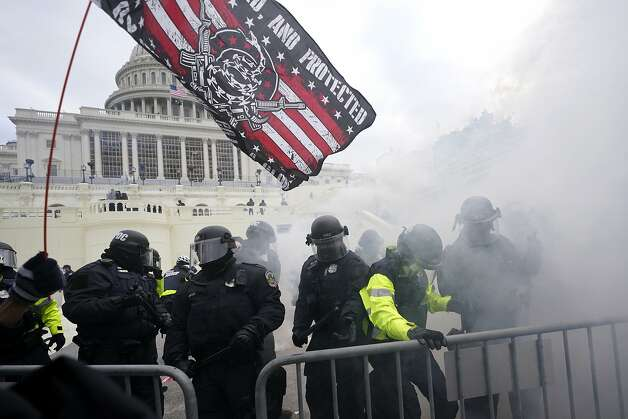 Police hold off Trump supporters who tried to break through a police barrier, Wednesday, Jan. 6, 2021, at the Capitol in Washington, DC. Photo: Julio Cortez, Associated Press