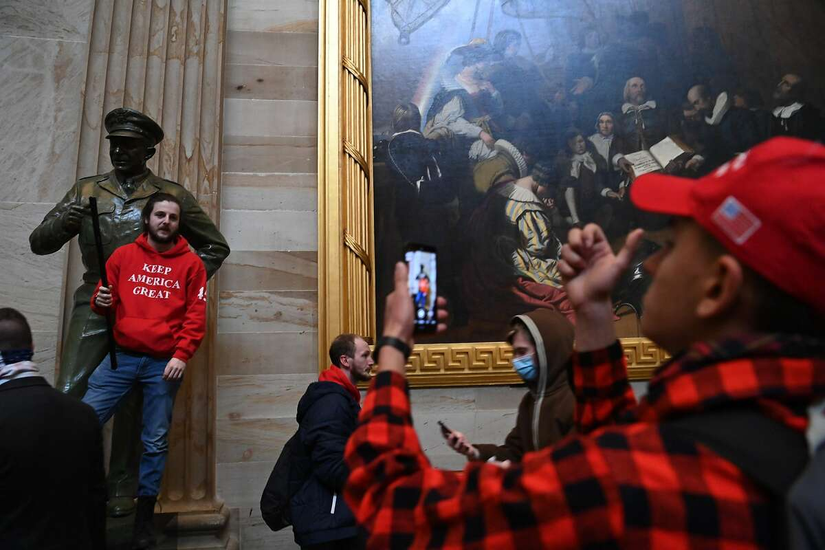 Supporters of President Donald Trump enter the US Capitol's Rotunda on January 6, 2021, in Washington, DC.