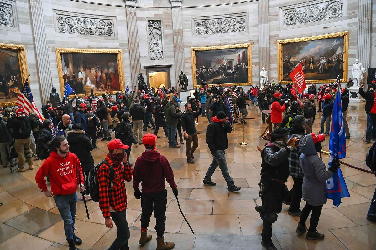 Supporters of President Donald Trump roam under the Capitol Rotunda after invading the Capitol building on January 6, 2021, in Washington, DC.
