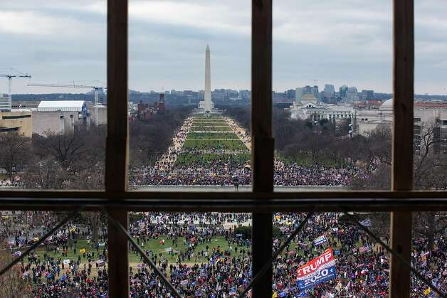 A crowd of Trump supporters gather outside as seen from inside the U.S. Capitol on January 6, 2021 in Washington, DC. Photo: Cheriss May, Getty Images