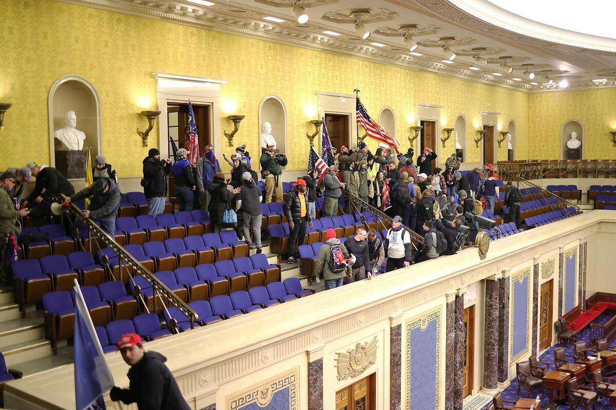 Trump supporters enter the Senate Chamber on January 06, 2021 in Washington, DC.