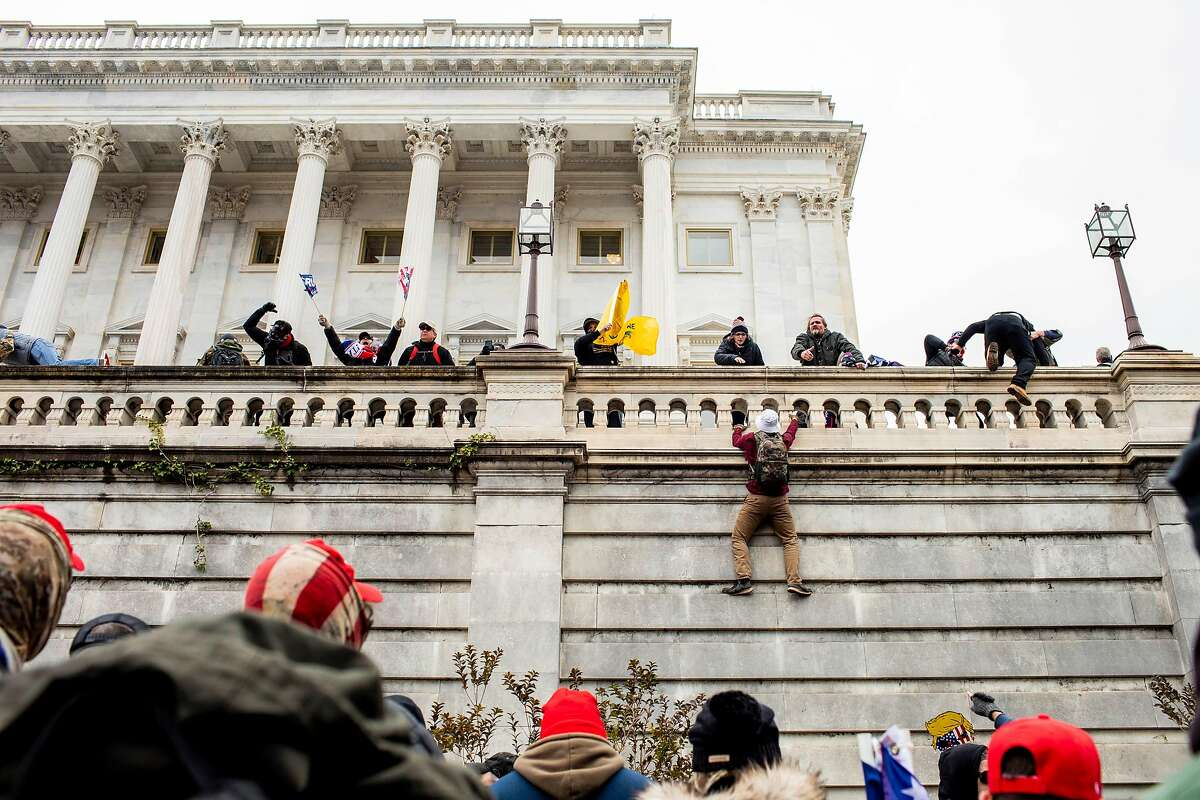 Trump supporters climb the Capitol in Washington on Wednesday, Jan. 6, 2021.