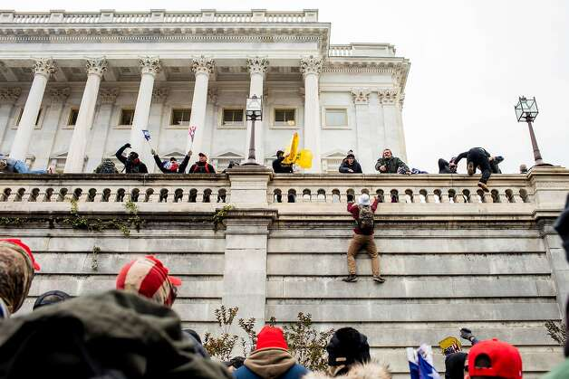 Trump supporters climb the Capitol in Washington on Wednesday, Jan. 6, 2021. Photo: Jason Andrew, NYT