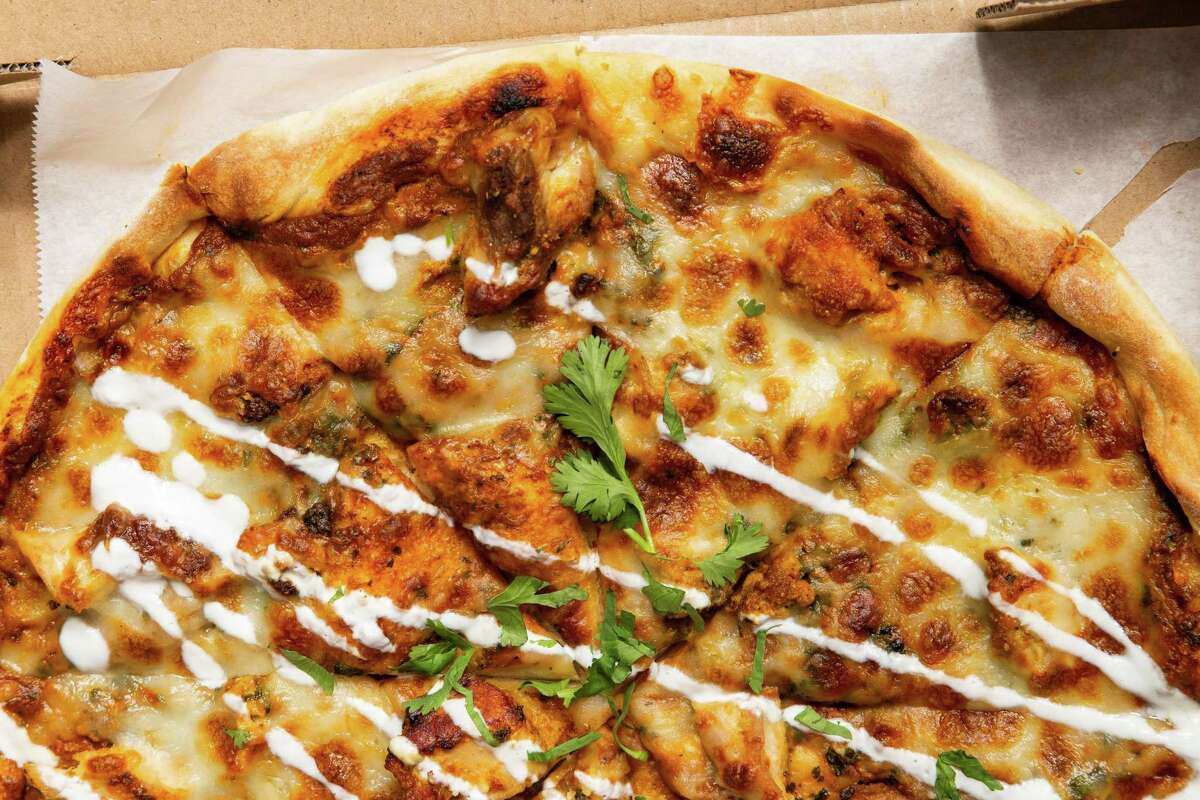 Sherkaan Indian Street Food has introduced Indian-style pizzas to its menu, with ingredients like butter chicken and palak paneer.