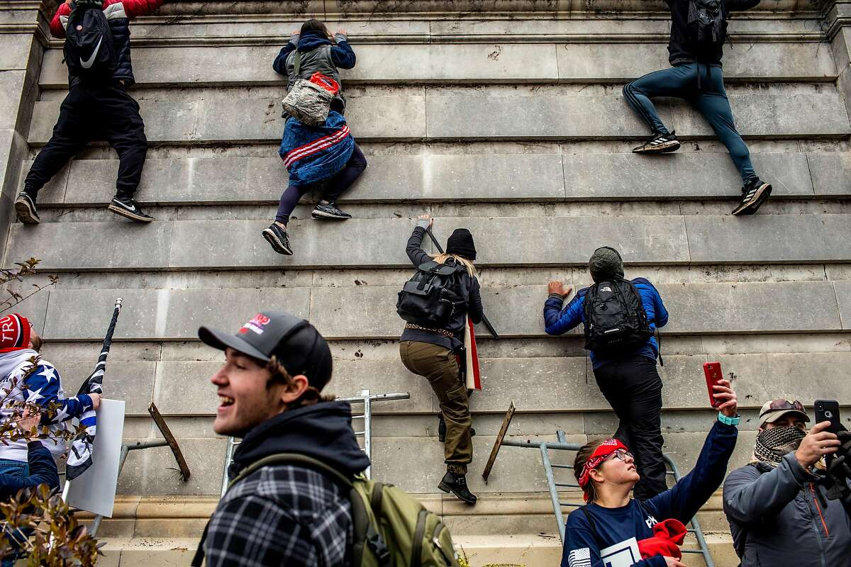 Trump supporters climb onto the Capitol in Washington on Wednesday, Jan. 6, 2021.