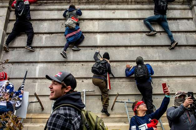 Trump supporters climb onto the Capitol in Washington on Wednesday, Jan. 6, 2021. Photo: Jason Andrew, NYT